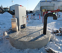 Photo of outdoor-rated wastewater control panel in snowy location