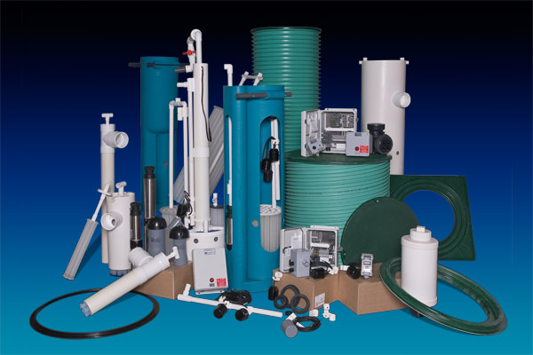 Photo of various Orenco septic and general onsite products. Whether you need risers and lids, tank adapters, pump basins, effluent filters, splice boxes, or control panels, Orenco's line of gravity & pump system products offers many advantages.