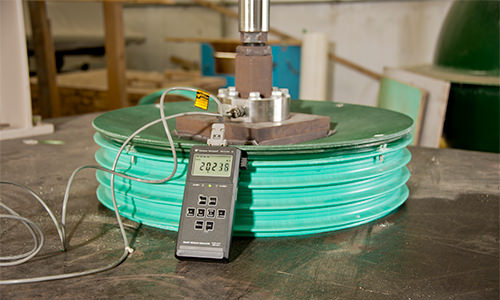 Photo of a fiberglass lid being strength tested